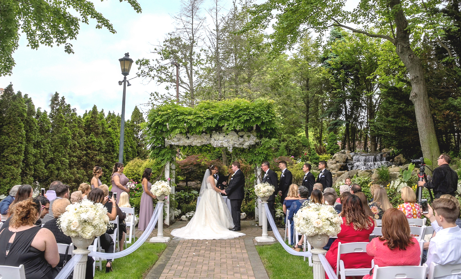 couple getting married wedding ceremony outside the fox hollow